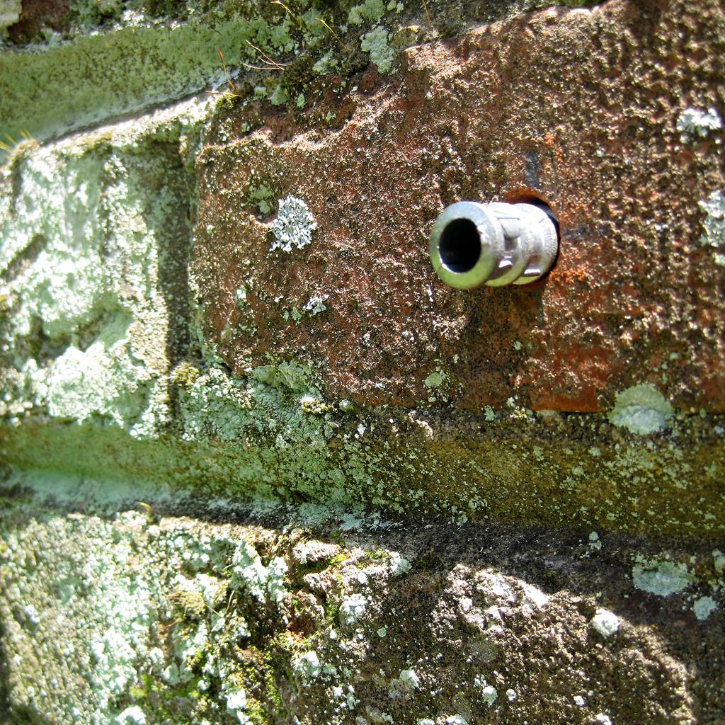 lead anchor brick wall