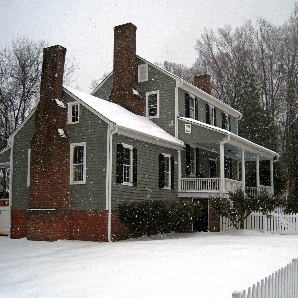 colonial house in snow